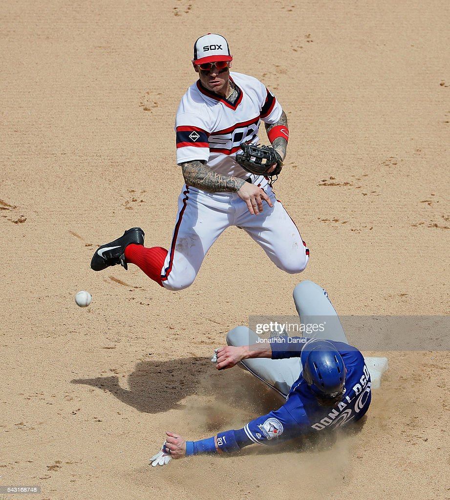Brett Lawrie #15 of the Chicago White Sox turns a double play over Josh Donaldson #20 of the Toronto Blue Jays in the 7th inning at U.S. Cellular Field on June 26, 2016 in Chicago, Illinois. The White Sox defeated the Blue Jays 5-2.