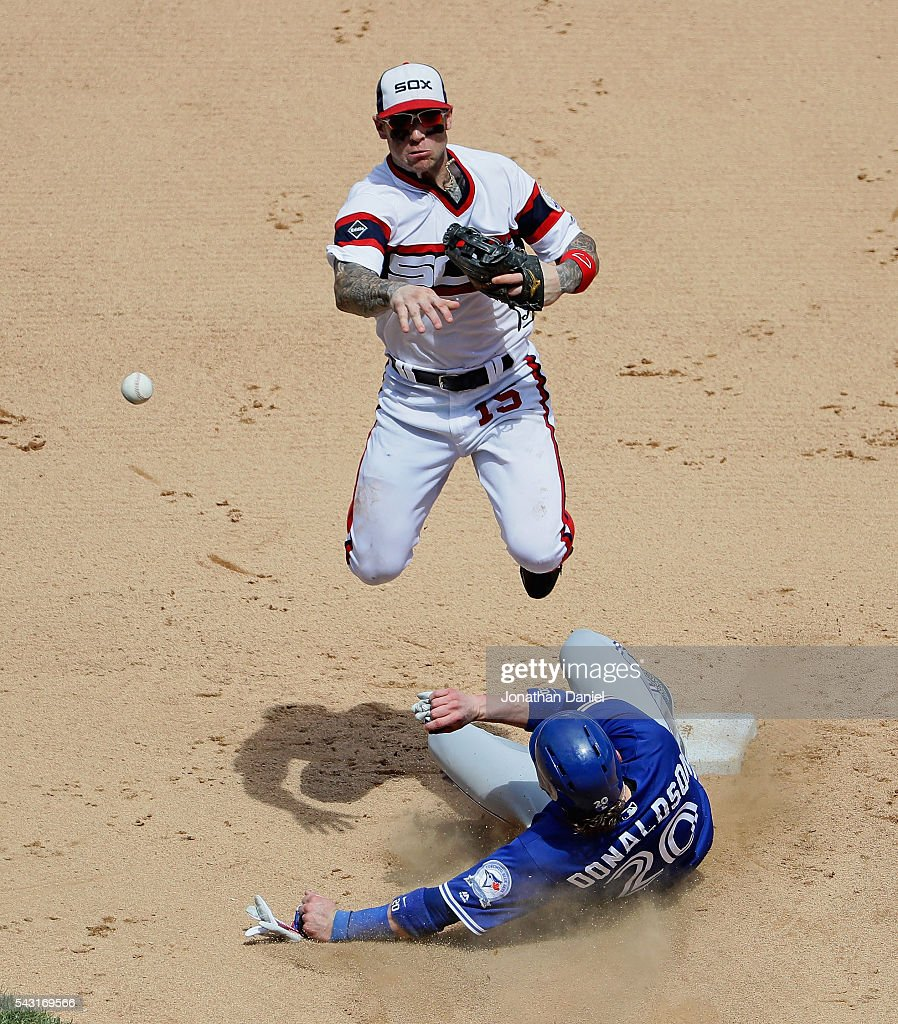 <a gi-track='captionPersonalityLinkClicked' href=/galleries/search?phrase=Brett+Lawrie&family=editorial&specificpeople=5496694 ng-click='$event.stopPropagation()'>Brett Lawrie</a> #15 of the Chicago White Sox turns a double play over <a gi-track='captionPersonalityLinkClicked' href=/galleries/search?phrase=Josh+Donaldson&family=editorial&specificpeople=4959442 ng-click='$event.stopPropagation()'>Josh Donaldson</a> #20 of the Toronto Blue Jays in the 7th inning at U.S. Cellular Field on June 26, 2016 in Chicago, Illinois. The White Sox defeated the Blue Jays 5-2.