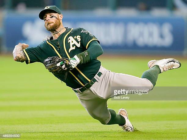 Brett Lawrie of the Oakland Athletics attempts to throw out Jed Lowrie of the Houston Astros at Minute Maid Park on September 20 2015 in Houston Texas