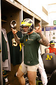 Brett Lawrie of the Oakland Athletics celebrates in the clubhouse following the game against the Los Angeles Angels of Anaheim at Oco Coliseum on...