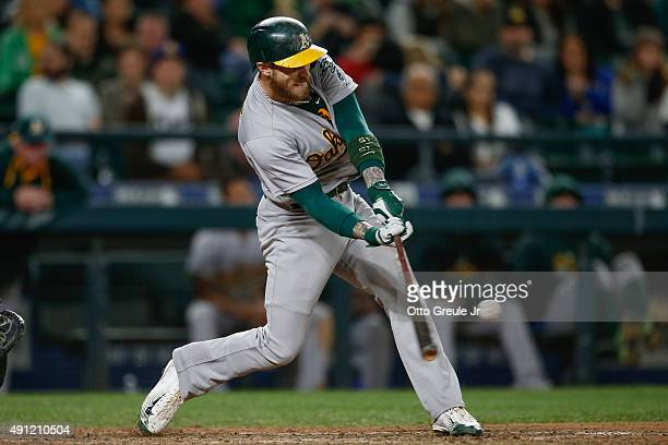 Brett Lawrie of the Oakland Athletics hits a sacrifice fly to tie the game 55 in the ninth inning against the Seattle Mariners at Safeco Field on...
