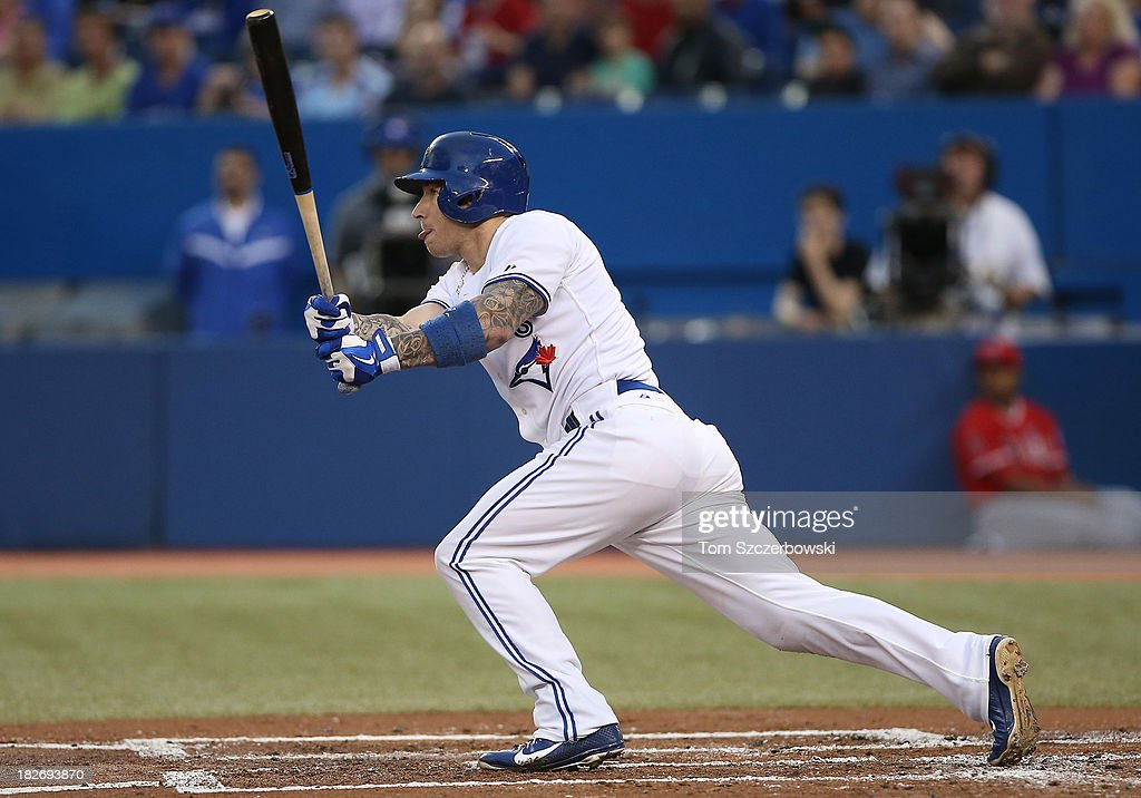 <a gi-track='captionPersonalityLinkClicked' href=/galleries/search?phrase=Brett+Lawrie&family=editorial&specificpeople=5496694 ng-click='$event.stopPropagation()'>Brett Lawrie</a> #13 of the Toronto Blue Jays bats in the first inning during MLB game action against the Los Angeles Angels of Anaheim on September 12, 2013 at Rogers Centre in Toronto, Ontario, Canada. (Photo by Tom Szczerbowski/Getty Images) ~~~