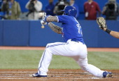 Brett Lawrie of the Toronto Blue Jays fails to execute a bunt in the second inning during MLB game action against the New York Yankees on April 5...