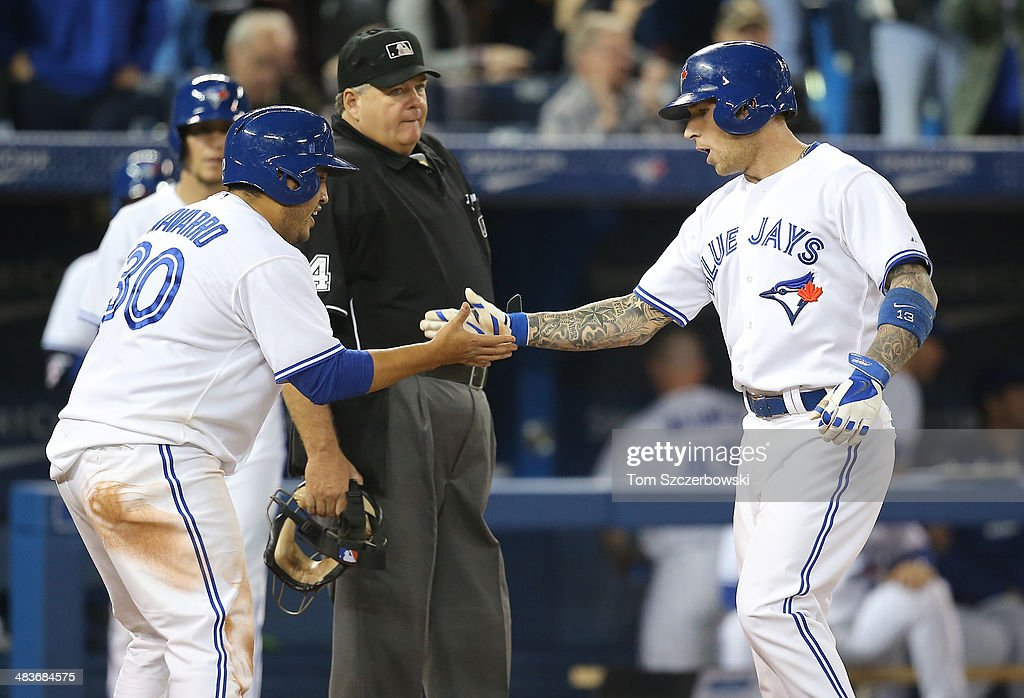 <a gi-track='captionPersonalityLinkClicked' href=/galleries/search?phrase=Brett+Lawrie&family=editorial&specificpeople=5496694 ng-click='$event.stopPropagation()'>Brett Lawrie</a> #13 of the Toronto Blue Jays is congratulated by <a gi-track='captionPersonalityLinkClicked' href=/galleries/search?phrase=Dioner+Navarro&family=editorial&specificpeople=593062 ng-click='$event.stopPropagation()'>Dioner Navarro</a> #30 after hitting a two-run home run in the seventh inning during MLB game action against the Houston Astros on April 9, 2014 at Rogers Centre in Toronto, Ontario, Canada.