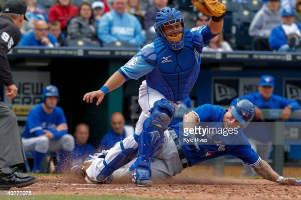 Brett Lawrie of the Toronto Blue Jays slides into home safe past catcher Humberto Quintero of the Kansas City Royals in the 8th during the game on...