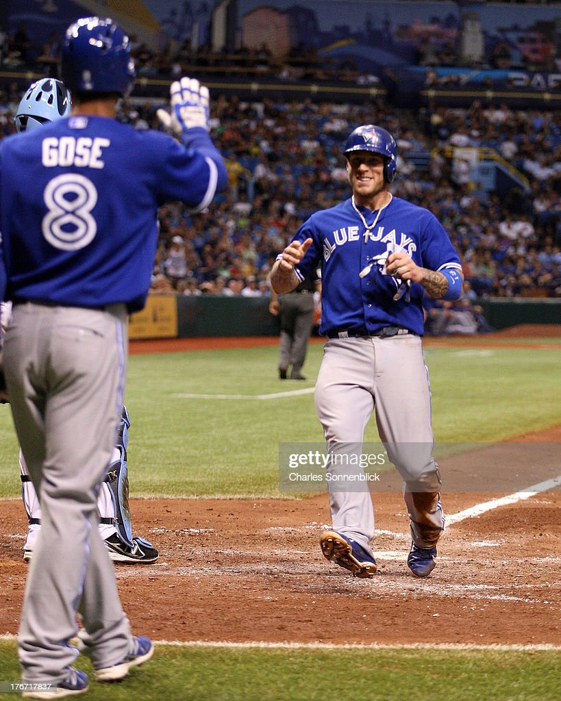 <a gi-track='captionPersonalityLinkClicked' href=/galleries/search?phrase=Brett+Lawrie&family=editorial&specificpeople=5496694 ng-click='$event.stopPropagation()'>Brett Lawrie</a> #13 of the Toronto Blue Jays steals home on a passed ball at third base in the sixth inning against the Tampa Bay Rays during the game on August 17, 2013 at Tropicana Field in St. Petersburg, Florida.