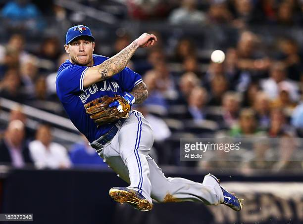 Brett Lawrie of the Toronto Blue Jays throws out Casey McGehee of the New York Yankees in the sixth inning during their game on September 19 2012 at...