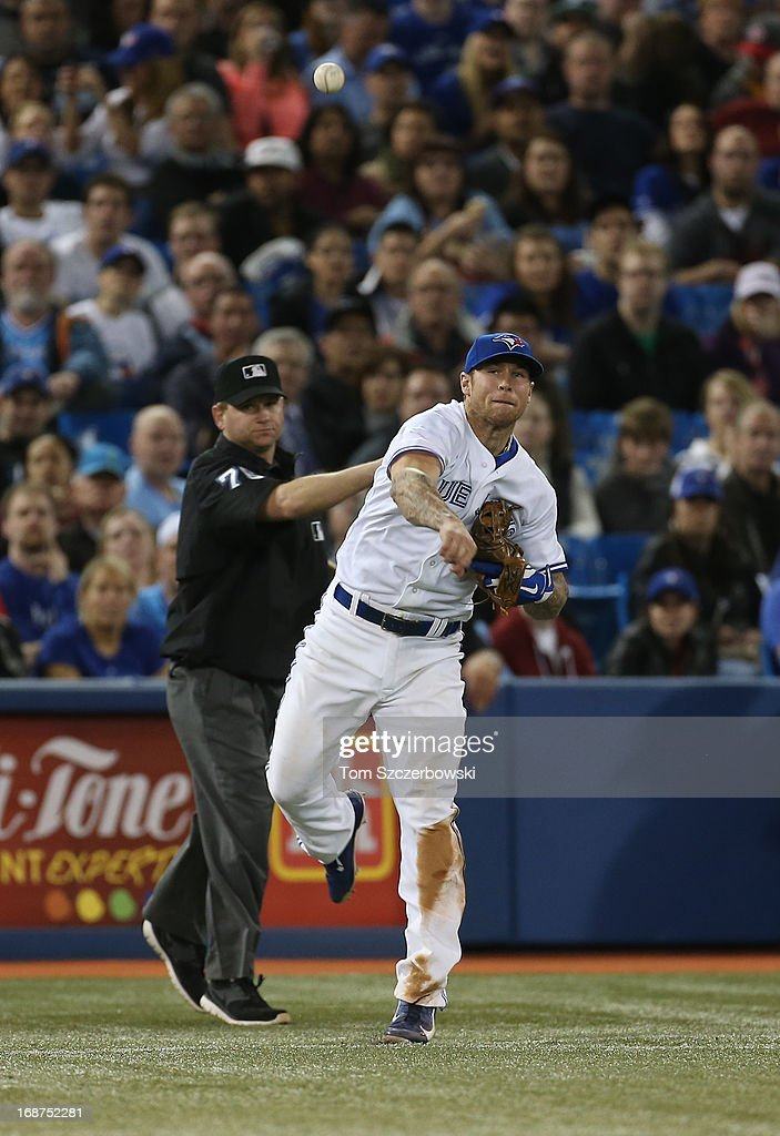 <a gi-track='captionPersonalityLinkClicked' href=/galleries/search?phrase=Brett+Lawrie&family=editorial&specificpeople=5496694 ng-click='$event.stopPropagation()'>Brett Lawrie</a> #13 of the Toronto Blue Jays throws out the baserunner in the eighth inning during MLB game action against the San Francisco Giants on May 14, 2013 at Rogers Centre in Toronto, Ontario, Canada.
