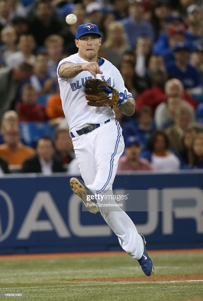 <a gi-track='captionPersonalityLinkClicked' href=/galleries/search?phrase=Brett+Lawrie&family=editorial&specificpeople=5496694 ng-click='$event.stopPropagation()'>Brett Lawrie</a> #13 of the Toronto Blue Jays throws out the baserunner in the seventh inning during MLB game action against the Baltimore Orioles on May 23, 2013 at Rogers Centre in Toronto, Ontario, Canada.