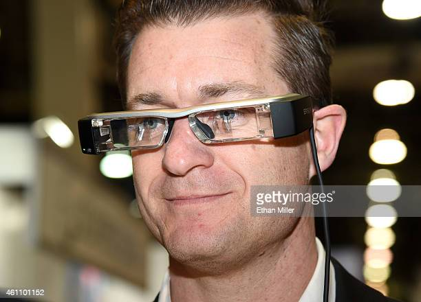 Brett Leary tries out Epson's BT200 Moverio smart glasses at the 2015 International CES at the Sands Expo and Convention Center on January 6 2015 in...