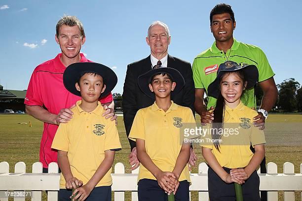 Brett Lee Greg Chappell and Gurinder Sandhu pose with school children during a Cricket Australia media announcement at Blacktown Sportspark on August...
