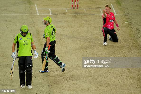 Brett Lee of the Sixers celebrates after taking the wicket of Mike Hussey of the Thunder during the Big Bash League match between the Sydney Thunder...