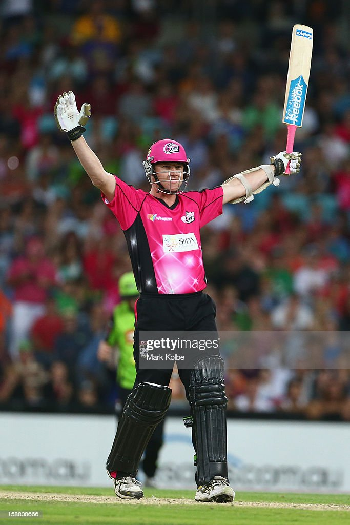 <a gi-track='captionPersonalityLinkClicked' href=/galleries/search?phrase=Brett+Lee&family=editorial&specificpeople=169885 ng-click='$event.stopPropagation()'>Brett Lee</a> of the Sixers celebrates hitting the winning runs during the Big Bash League match between Sydney Thunder and the Sydney Sixers at ANZ Stadium on December 30, 2012 in Sydney, Australia.