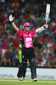 Brett Lee of the Sixers celebrates hitting the winning runs during the Big Bash League match between Sydney Thunder and the Sydney Sixers at ANZ...