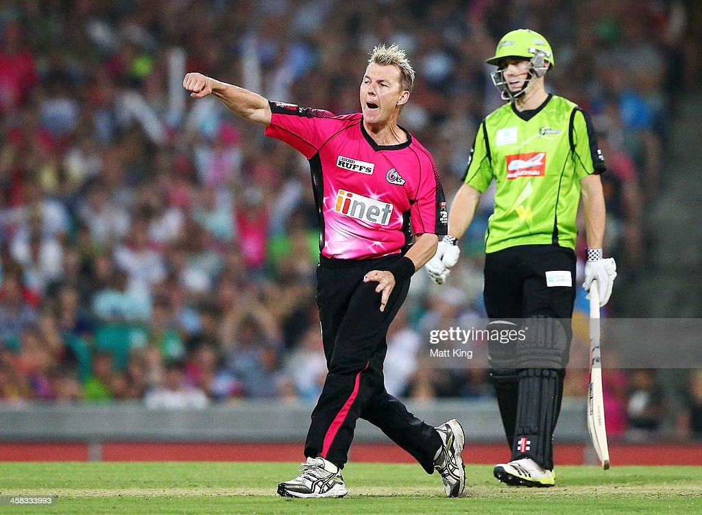 <a gi-track='captionPersonalityLinkClicked' href=/galleries/search?phrase=Brett+Lee&family=editorial&specificpeople=169885 ng-click='$event.stopPropagation()'>Brett Lee</a> of the Sixers celebrates taking the wicket of Blake Dean of the Thunder during the Big Bash League match between the Sydney Sixers and Sydney Thunder at SCG on December 21, 2013 in Sydney, Australia.