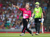 Brett Lee of the Sixers celebrates taking the wicket of Blake Dean of the Thunder during the Big Bash League match between the Sydney Sixers and...