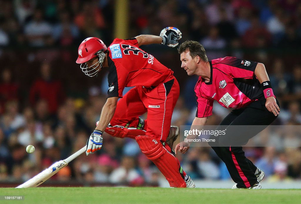 <a gi-track='captionPersonalityLinkClicked' href=/galleries/search?phrase=Brett+Lee&family=editorial&specificpeople=169885 ng-click='$event.stopPropagation()'>Brett Lee</a> of the Sixers runs out Will Sheridan of the Renegades during the Big Bash League match between the Sydney Sixers and the Melbourne Renegades at SCG on January 9, 2013 in Sydney, Australia.