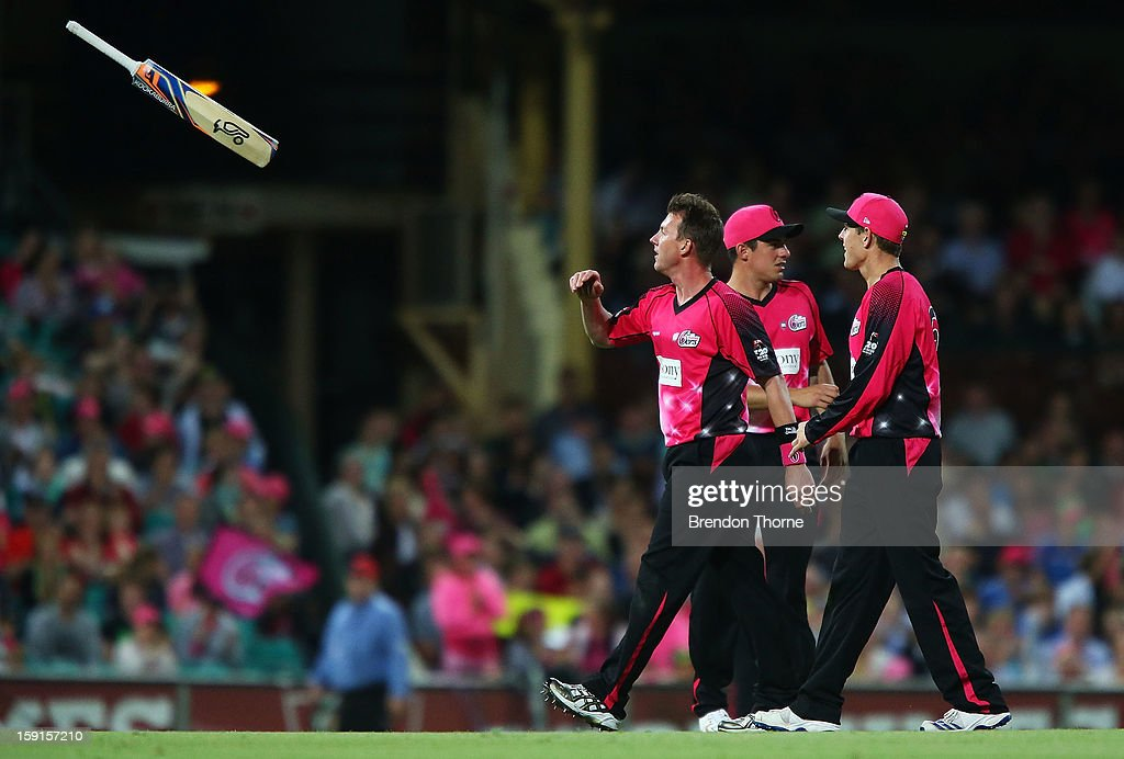 <a gi-track='captionPersonalityLinkClicked' href=/galleries/search?phrase=Brett+Lee&family=editorial&specificpeople=169885 ng-click='$event.stopPropagation()'>Brett Lee</a> of the Sixers throws Will Sheridan of the Renegades his bat after running him out during the Big Bash League match between the Sydney Sixers and the Melbourne Renegades at SCG on January 9, 2013 in Sydney, Australia.