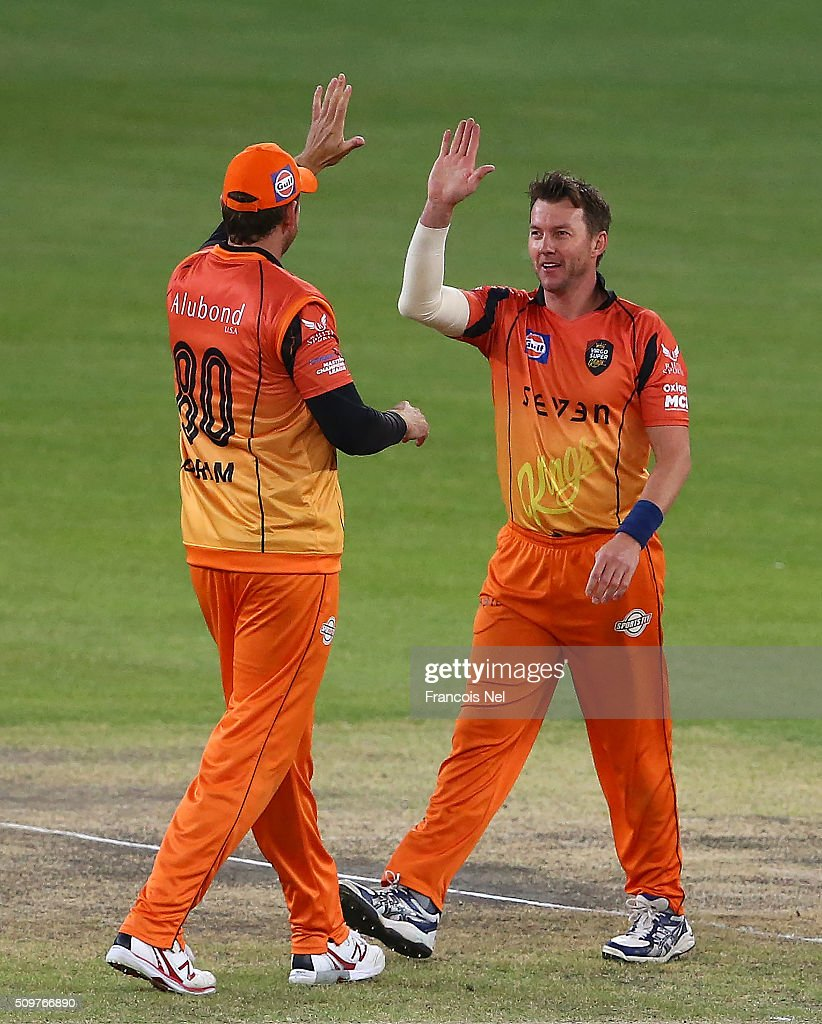<a gi-track='captionPersonalityLinkClicked' href=/galleries/search?phrase=Brett+Lee&family=editorial&specificpeople=169885 ng-click='$event.stopPropagation()'>Brett Lee</a> of Virgo Super Kings (R) celebrates the wicket of Neil Carter of Leo Lions with team-mate <a gi-track='captionPersonalityLinkClicked' href=/galleries/search?phrase=Jacob+Oram&family=editorial&specificpeople=171456 ng-click='$event.stopPropagation()'>Jacob Oram</a> during the Oxigen Masters Champions League Semi Final match between Leo Lions and Virgo Super Kings at Dubai International Cricket Stadium on February 12, 2016 in Dubai, United Arab Emirates.