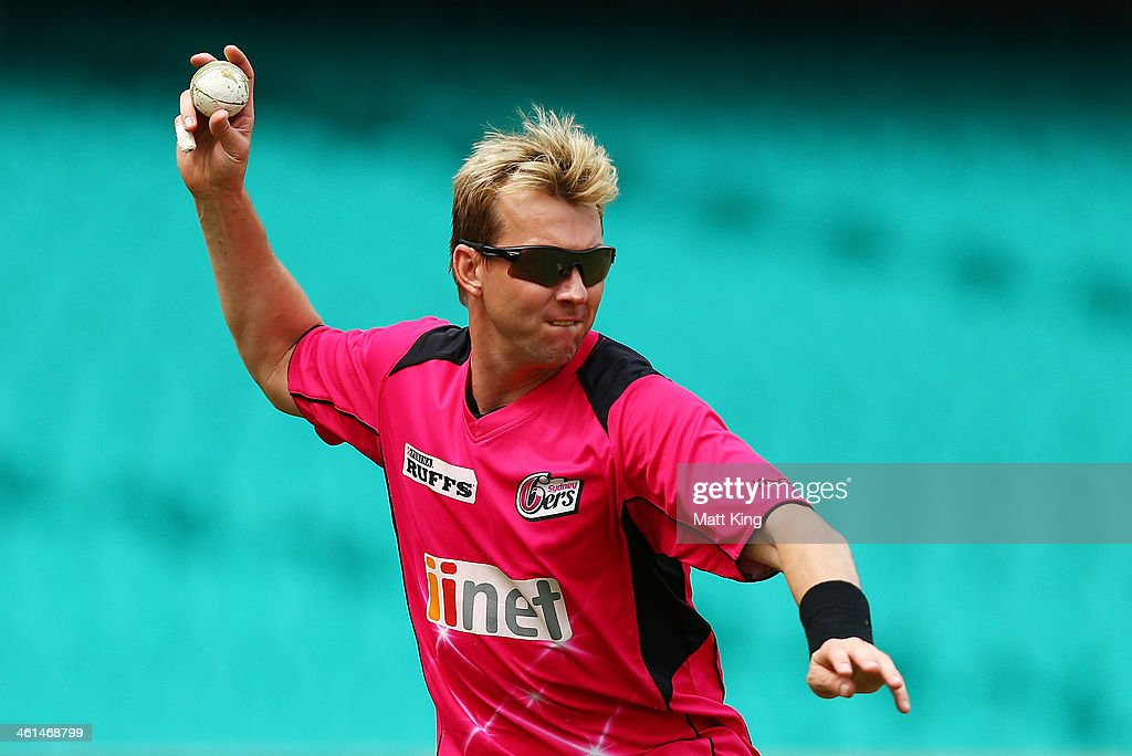 <a gi-track='captionPersonalityLinkClicked' href=/galleries/search?phrase=Brett+Lee&family=editorial&specificpeople=169885 ng-click='$event.stopPropagation()'>Brett Lee</a> throws during fielding practice during a Sydney Sixers Big Bash League training/media session at Sydney Cricket Ground on January 9, 2014 in Sydney, Australia.