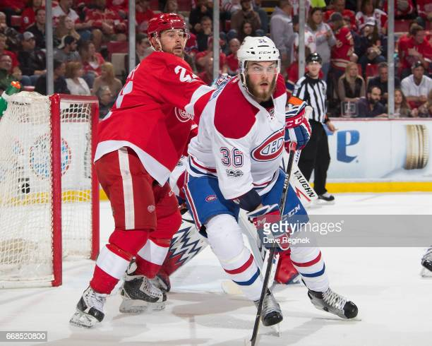 Brett Lernout of the Montreal Canadiens battles for position with Tomas Tatar of the Detroit Red Wings during an NHL game at Joe Louis Arena on April...