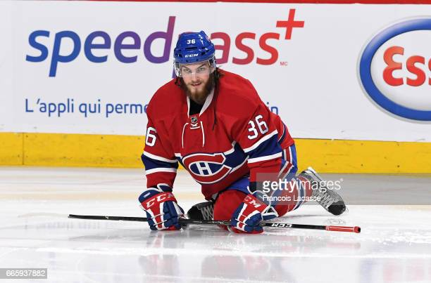 Brett Lernout of the Montreal Canadiens stretches before a game against the Tampa Bay Lightning in the NHL game at the Bell Centre on April 7 2017 in...