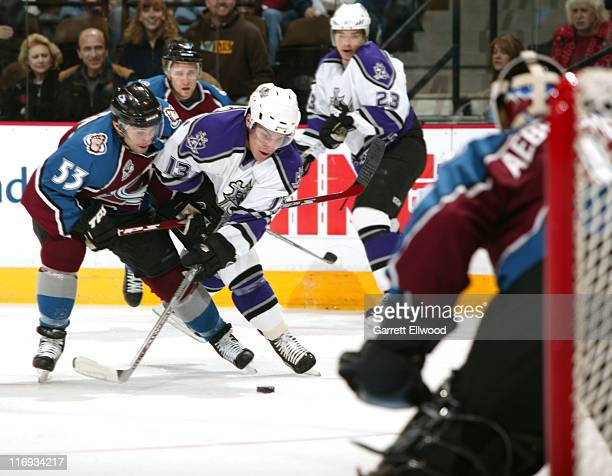 Brett McLean of the Colorado Avalanche battles for the puck with Michael Cammalleri of the Los Angeles Kings during the game between the Los Angeles...