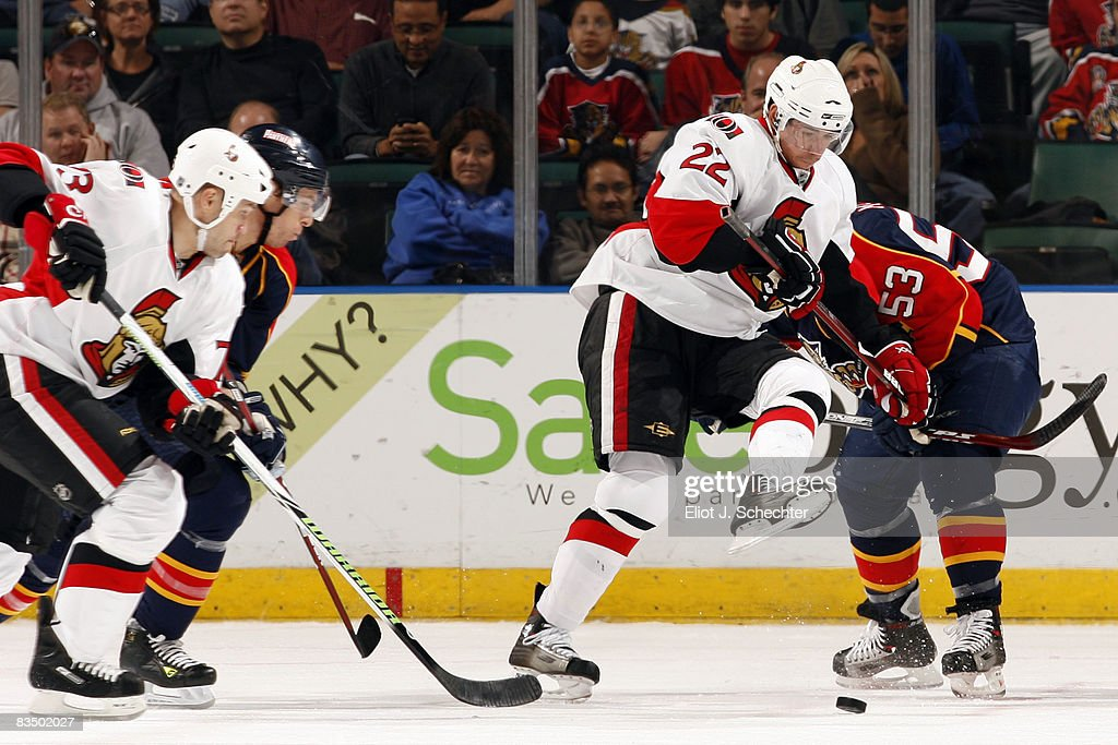 Brett McLean of the Florida Panthers battles for the puck against Chris Kelly of the Ottawa Senators at the BankAtlantic Center October 30 2008 in...