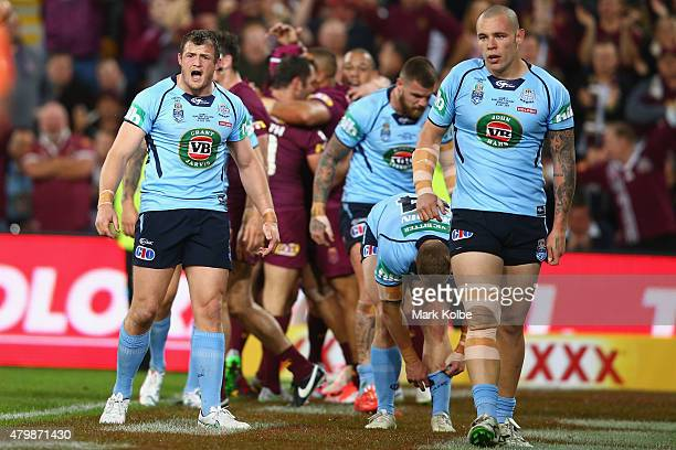 Brett Morris and David Klemmer of the Blues looks dejected after a Maroons try during game three of the State of Origin series between the Queensland...