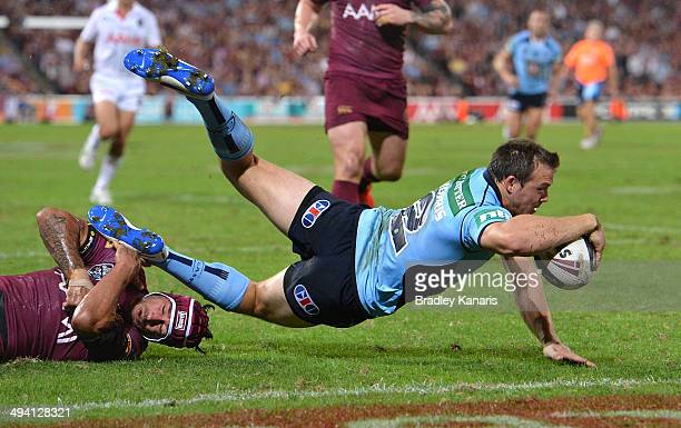 Brett Morris of the Blues scores a try during game one of the State of Origin series between the Queensland Maroons and the New South Wales Blues at...