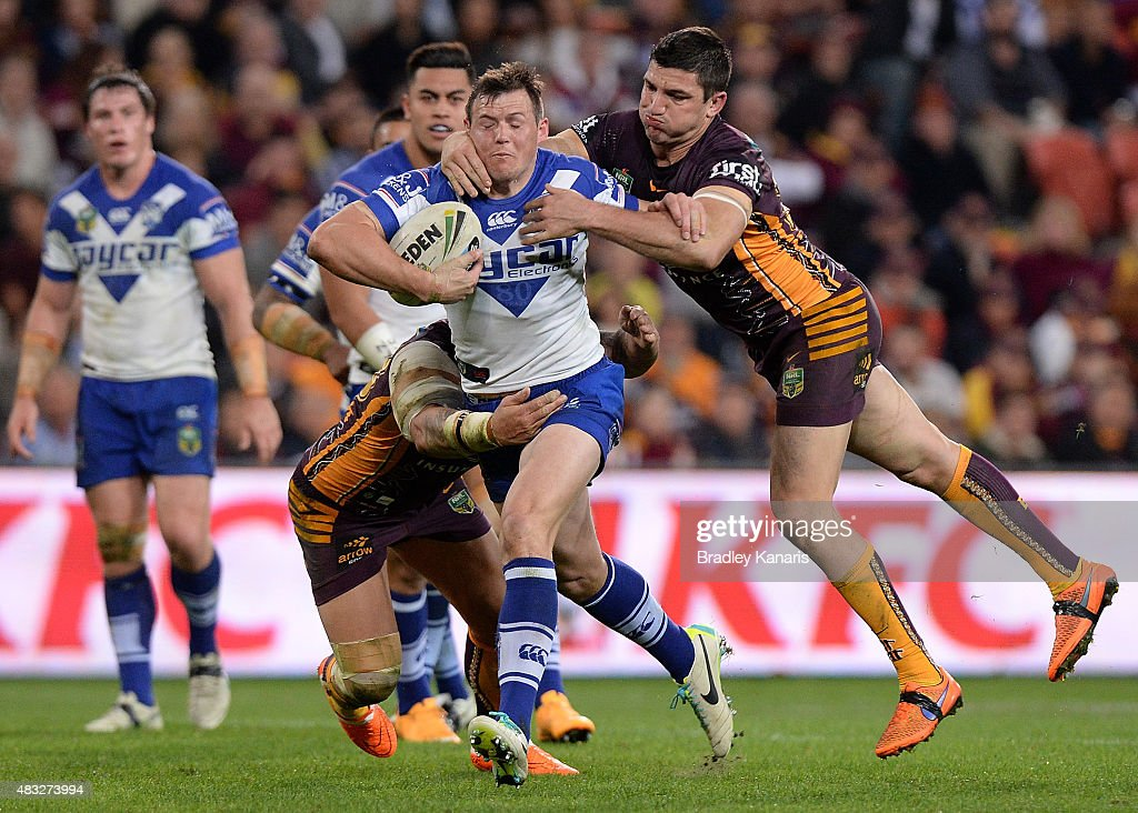 Brett Morris of the Bulldogs attempts to break through the defence during the round 22 NRL match between the Brisbane Broncos and the Canterbury Bulldogs at Suncorp Stadium on August 7, 2015 in Brisbane, Australia.
