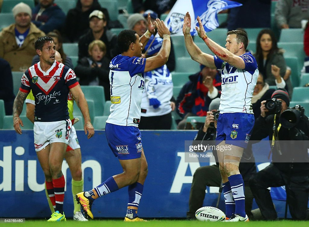 <a gi-track='captionPersonalityLinkClicked' href=/galleries/search?phrase=Brett+Morris&family=editorial&specificpeople=566169 ng-click='$event.stopPropagation()'>Brett Morris</a> of the Bulldogs celebrates scoring a try during the round 17 NRL match between the Sydney Roosters and the Canterbury Bulldogs at Allianz Stadium on June 30, 2016 in Sydney, Australia.