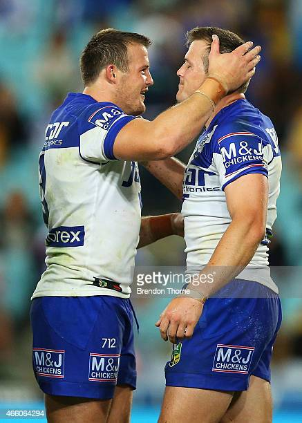 Brett Morris of the Bulldogs celebrates with his brother Josh Morris after scoring a try during the round two NRL match between the Canterbury...