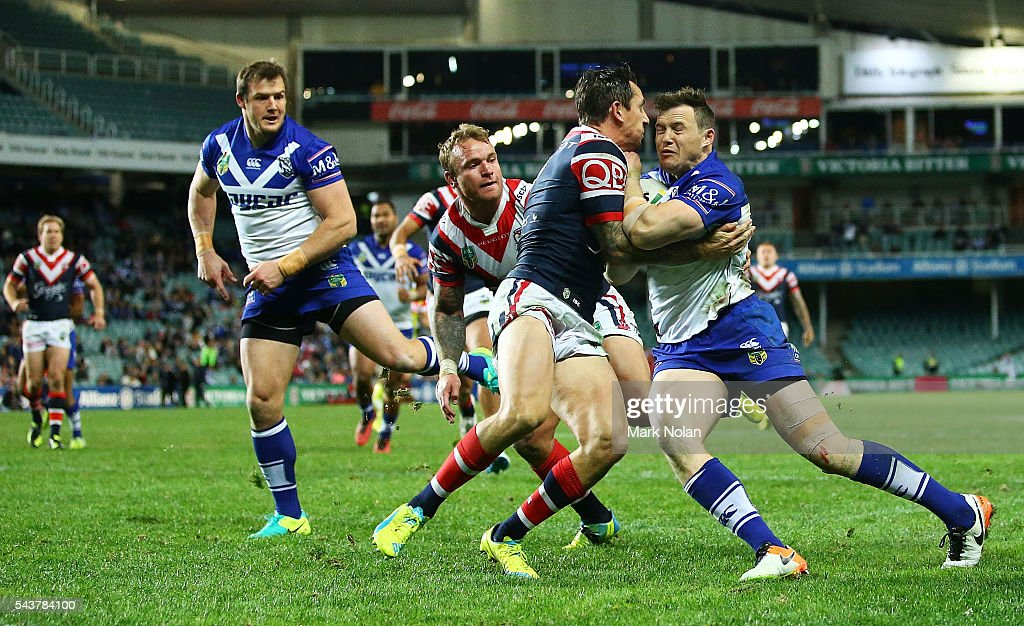 Brett Morris of the Bulldogs heads for the try line to score during the round 17 NRL match between the Sydney Roosters and the Canterbury Bulldogs at Allianz Stadium on June 30, 2016 in Sydney, Australia.