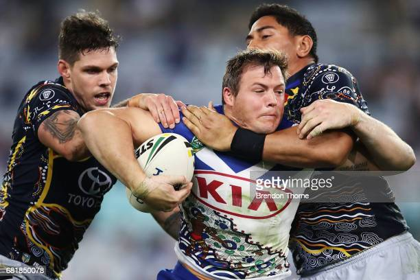Brett Morris of the Bulldogs is tackled by the Cowboys defence during the round 10 NRL match between the Canterbury Bulldogs and the North Queensland...