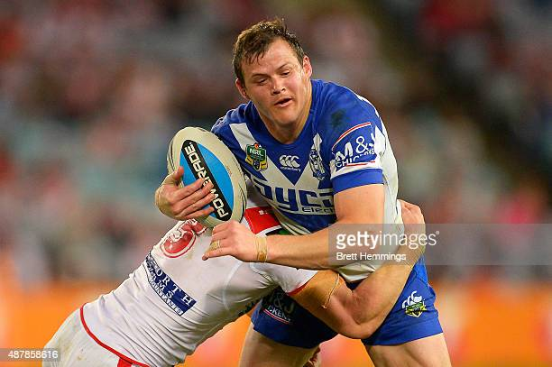 Brett Morris of the Bulldogs is tackled during the NRL Elimination Final match between the Canterbury Bulldogs and the St George Illawarra Dragons at...