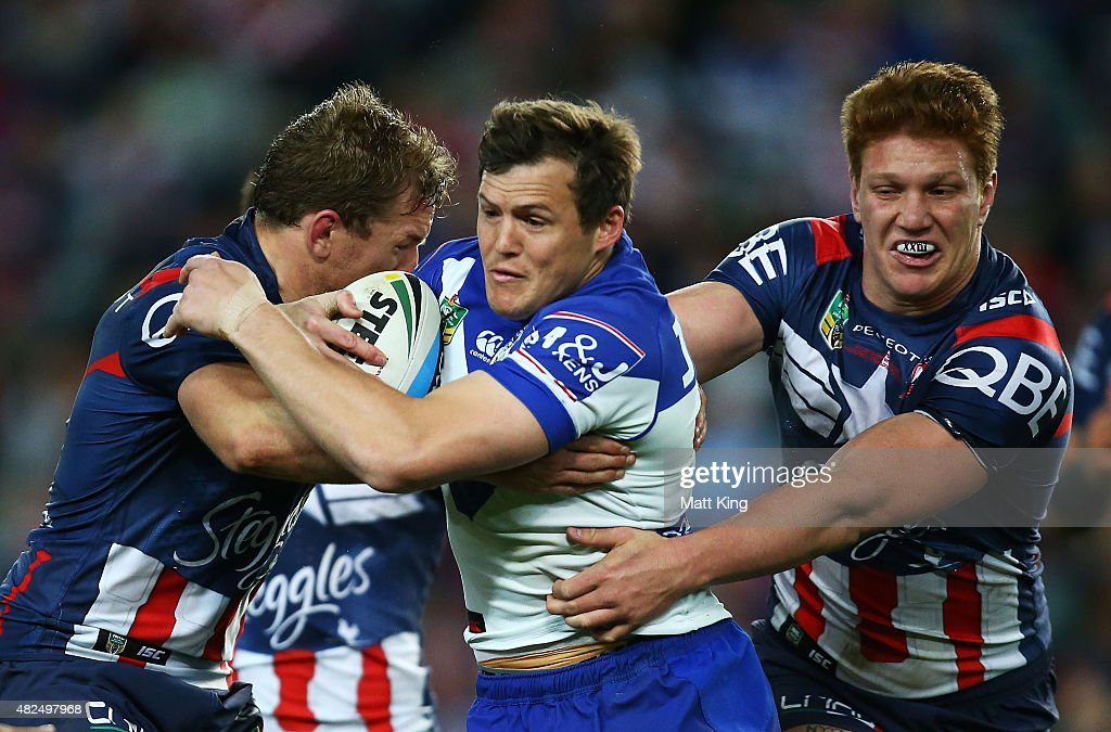 Brett Morris of the Bulldogs is tackled during the round 21 NRL match between the Sydney Roosters and the Canterbury Bulldogs at Allianz Stadium on July 31, 2015 in Sydney, Australia.