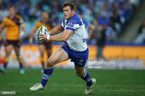 Brett Morris of the Bulldogs runs the ball during the round 18 NRL match between the Canterbury Bulldogs and the Brisbane Broncos at ANZ Stadium on...