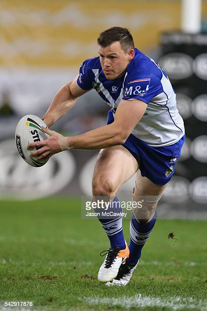 Brett Morris of the Bulldogs runs with the ball during the round 16 NRL match between the Canterbury Bulldogs and Brisbane Broncos at ANZ Stadium on...
