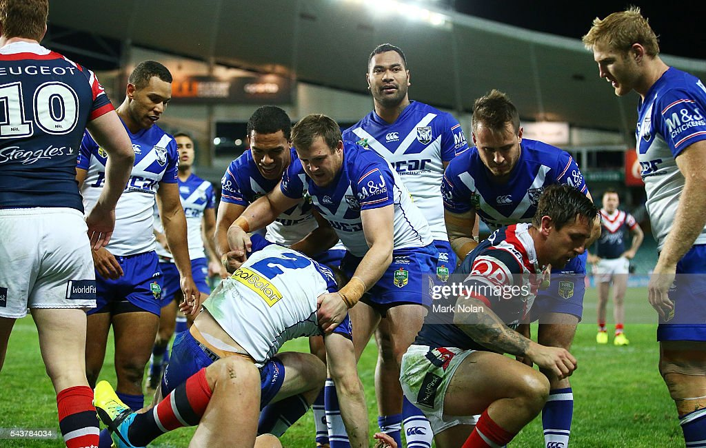 <a gi-track='captionPersonalityLinkClicked' href=/galleries/search?phrase=Brett+Morris&family=editorial&specificpeople=566169 ng-click='$event.stopPropagation()'>Brett Morris</a> of the Bulldogs scores a try during the round 17 NRL match between the Sydney Roosters and the Canterbury Bulldogs at Allianz Stadium on June 30, 2016 in Sydney, Australia.