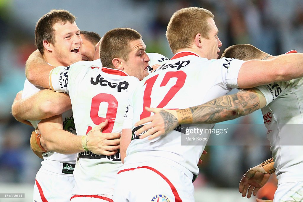 Brett Morris of the Dragons celebrates with his team mates after scoring the match winning try during golden point time of the round 19 NRL match between the South Sydney Rabbitohs and the St George Illawarra Dragons at ANZ Stadium on July 22, 2013 in Sydney, Australia.