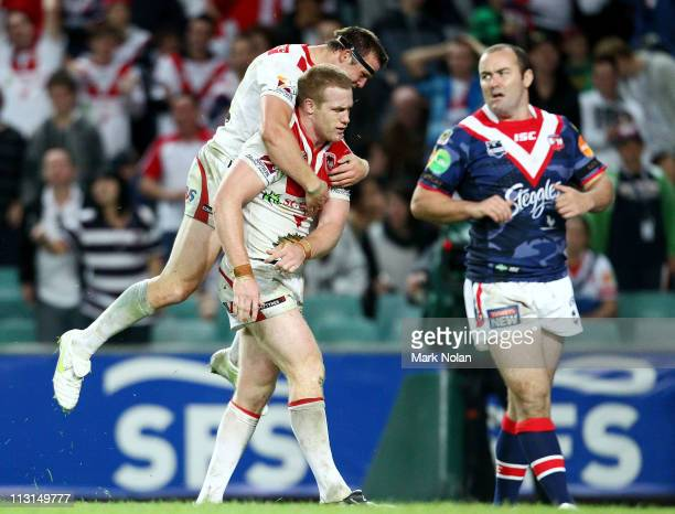 Brett Morris of the Dragons congratulates team mate Ben Creagh after he scored during the round seven NRL match between the Sydney Roosters and the...