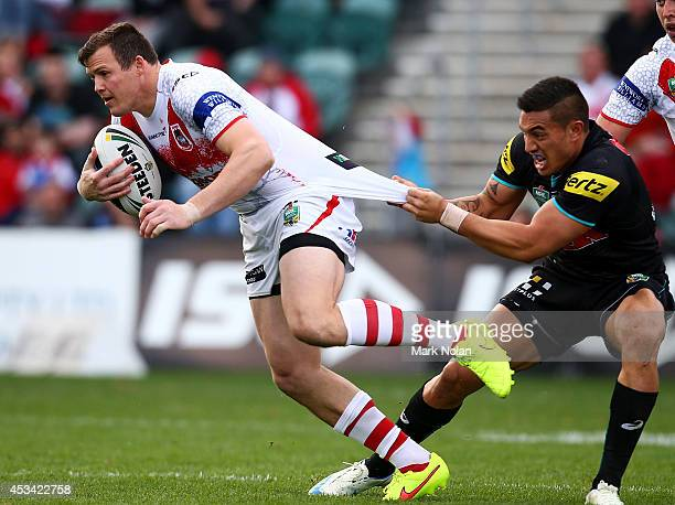 Brett Morris of the Dragons is tackled during the round 22 NRL match between the St George Dragons and the Penrith Panthers at WIN Stadium on August...