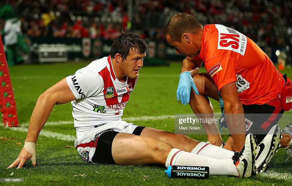 Brett Morris of the Dragons receives attention for a knee injury during the round eight NRL match between the St George Illawarra Dragons and the Manly Sea Eagles at WIN Jubilee Stadium on May 6, 2013 in Sydney, Australia.