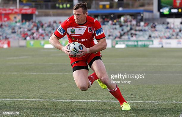 Brett Morris of the Dragons runs in a try during the round 23 NRL match between the Canberra Raiders and the St George Illawarra Dragons at GIO...