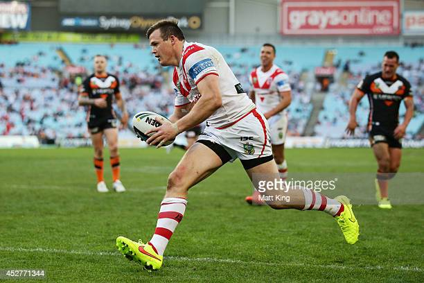 Brett Morris of the Dragons scores a try during the round 20 NRL match between the Wests Tigers and the St George Illawarra Dragons at ANZ Stadium on...