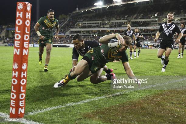 Brett Morris of the Kangaroos scores a try during the ANZAC Test match between the Australian Kangaroos and the New Zealand Kiwis at Canberra Stadium...