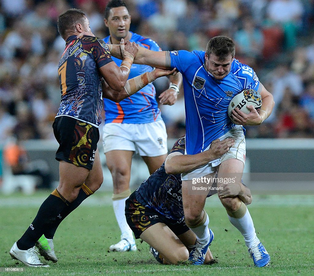 Brett Morris of the NRL All Stars attempts to break away from the defence during the NRL All Stars Game between the Indigenous All Stars and the NRL All Stars at Suncorp Stadium on February 9, 2013 in Brisbane, Australia.