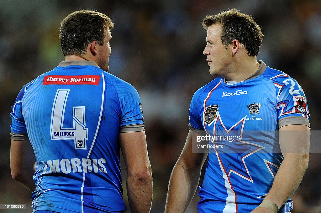 Brett Morris (R) speaks with his brother Josh Morris of the NRL All Stars during the NRL All Stars Game between the Indigenous All Stars and the NRL All Stars at Suncorp Stadium on February 9, 2013 in Brisbane, Australia.