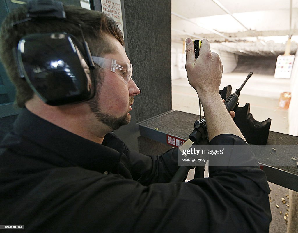 Brett Nielsen adjusts the sights of an AR-15 rifle at the 'Get Some Guns & Ammo' shooting range on January 15, 2013 in Salt Lake City, Utah. Lawmakers are calling for tougher gun legislation after recent mass shootings at an Aurora, Colorado movie theater and at Sandy Hook Elementary School in Newtown, Connecticut.